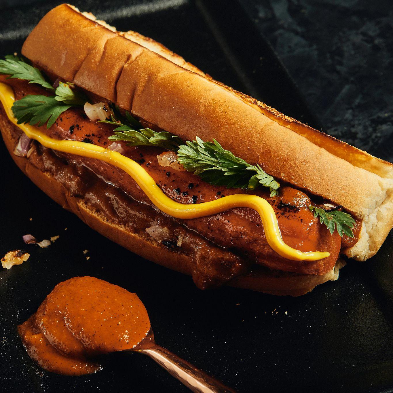Plants Pushing Boundaries Brined Carrot Hot Dog with charred tomato ketchup