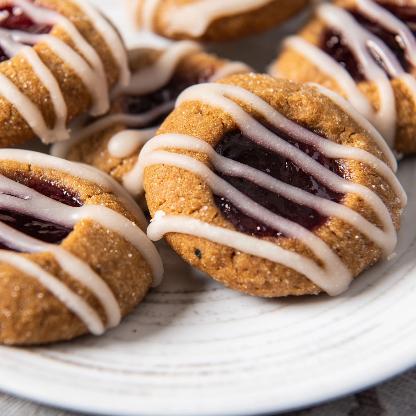 Cherry Almond Gingerbread Thumbprint Cookies with Vanilla Drizzle