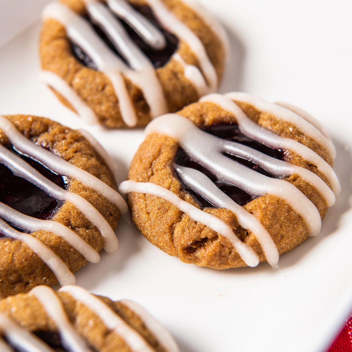Blackberry Rum Gingerbread Thumbprint Cookies with Vanilla Drizzle